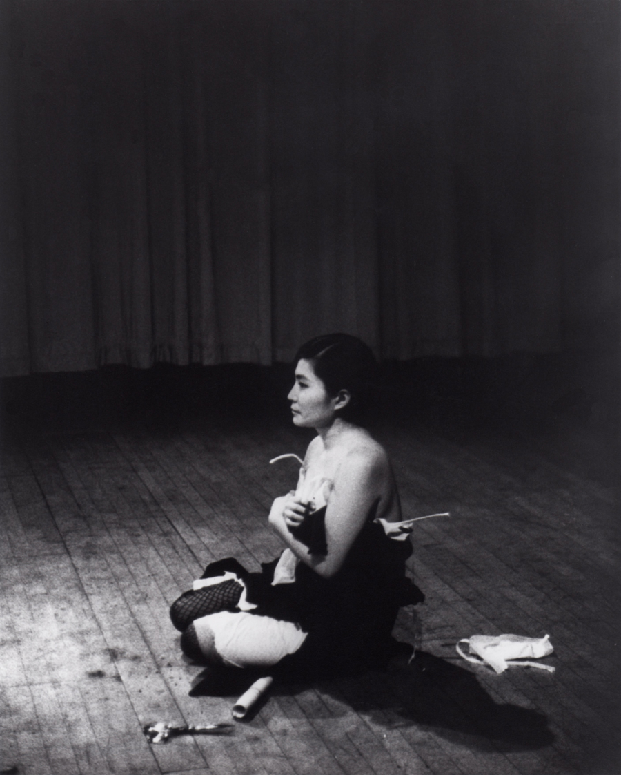 Yoko Ono. Cut Piece. 1964. Performed by Yoko Ono in New Works of Yoko Ono, Carnegie Recital Hall, New York, March 21, 1965. Photograph by Minoru Nii